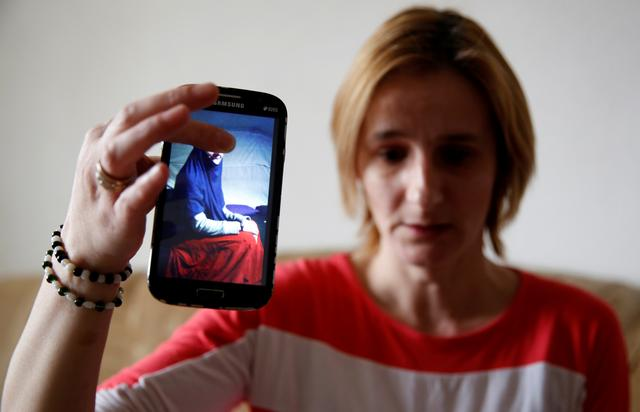 Alema Dolamic shows a picture of her sister who went to Syria, in Bedaci village, near Tesanj, Bosnia and Herzegovina, March 5, 2019. REUTERS/Dado Ruvic