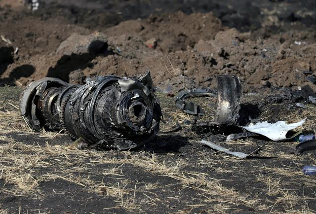 Engine parts are seen at the scene of the Ethiopian Airlines Flight ET 302 plane crash, near the town of Bishoftu, southeast of Addis Ababa, Ethiopia March 11, 2019. REUTERS/Tiksa Negeri