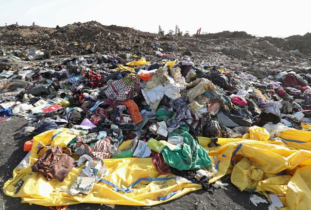 Clothing and personal effects from passengers are seen near the wreckage at the scene of the Ethiopian Airlines Flight ET 302 plane crash, near the town of Bishoftu, southeast of Addis Ababa, Ethiopia March 11, 2019. REUTERS/Tiksa Negeri