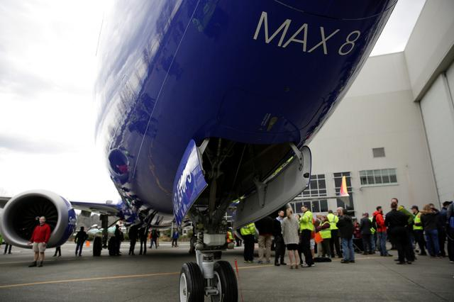 FILE PHOTO: Boeing employees are pictured in front of a 737 MAX 8 produced for Southwest Airlines as Boeing celebrates the 10,000th 737 to come off the production line in Renton, Washington, U.S., March 13, 2018.  REUTERS/Jason Redmond