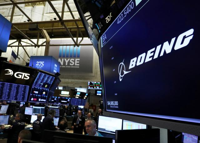 FILE PHOTO: The company logo for Boeing is displayed on a screen on the floor of the New York Stock Exchange (NYSE) in New York, U.S., March 11, 2019. REUTERS/Brendan McDermid