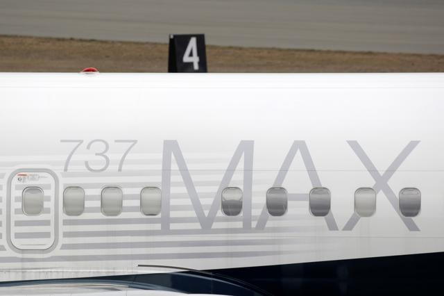 FILE PHOTO: A Boeing 737 MAX 8 aircraft is parked at a Boeing production facility in Renton, Washington, U.S., March 11, 2019. REUTERS/David Ryder