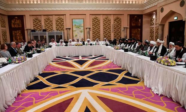 Undated Handout picture of U.S., Taliban and Qatar officials during a meeting for peace talks in Doha, Qatar. Qatari Foreign Ministry/Handout via REUTERS