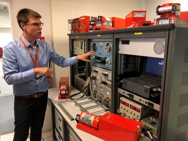 An official from FranceÕs BEA air crash investigation agency speaks near the machines used to listen to tapes that are recovered from black boxes during a press visit at their offices in Le Bourget, France, September 14, 2018. Picture taken September 14, 2018.   REUTERS/Tim Hepher