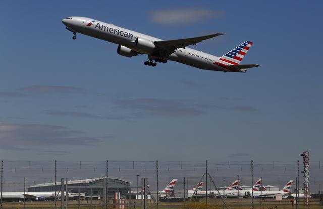 FILE PHOTO: An American Airlines airplane takes off from Heathrow airport in London July 3, 2014. REUTERS/Luke MacGregor