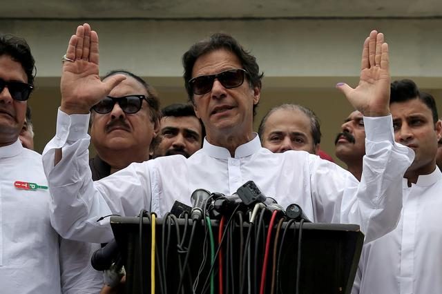 FILE PHOTO: Cricket star-turned-politician Imran Khan, chairman of Pakistan Tehreek-e-Insaf (PTI), speaks after voting in the general election in Islamabad, July 25, 2018. REUTERS/Athit Perawongmetha/File Photo