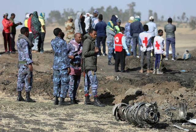 FILE PHOTO - Ethiopian Federal policemen stand near engine parts at the scene of the Ethiopian Airlines Flight ET 302 plane crash, near the town of Bishoftu, southeast of Addis Ababa, Ethiopia March 11, 2019. REUTERS/Tiksa Negeri