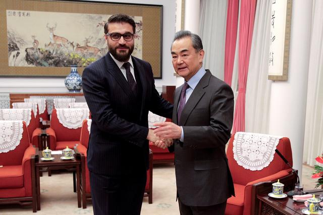 FILE PHOTO: Afghanistan National Security Advisor Hamdullah Mohib shakes hands with Chinese Foreign Minister Wang Yi before their meeting at the Zhongnanhai Leadership Compound in Beijing, China January 10, 2019. Andy Wong/Pool via REUTERS/File Photo