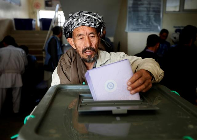 FILE PHOTO: An Afghan man casts his vote during the parliamentary election at a polling station in Kabul, Afghanistan October 21, 2018. REUTERS/Omar Sobhani/File Photo