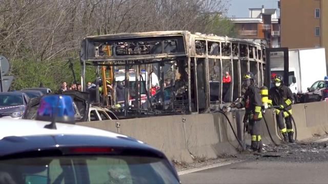 The wreckage of a bus that was set ablaze by its driver in protest against the treatment of migrants trying to cross the Mediterranean Sea, is seen on a road in Milan, Italy, March 20, 2019. Local Team via Reuters TV/Reuters