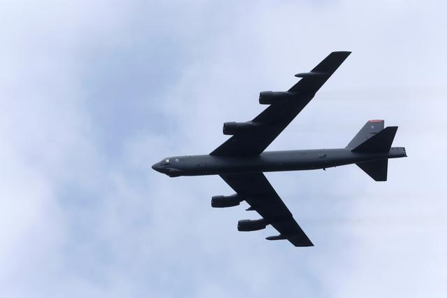 FILE PHOTO: U.S. bomber B-52 flies over during the final day of NATO Saber Strike exercises in Orzysz, Poland, June 16, 2017. REUTERS/Ints Kalnins