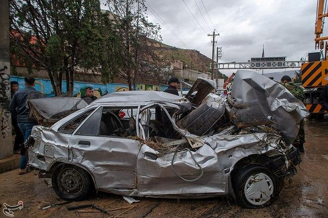 Damaged vehicles are seen after a flash flooding In Shiraz, Iran, March 25, 2019. Tasnim News Agency/Handout via REUTERS