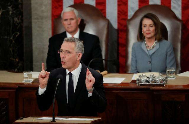 FILE PHOTO - NATO Secretary General Jens Stoltenberg addresses a joint meeting of the U.S. Congress as Vice President Mike Pence and Speaker of the House Nancy Pelosi listen in the House Chamber on Capitol Hill in Washington, U.S., April 3, 2019. REUTERS/Carlos Barria