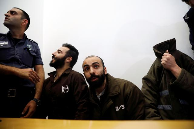 FILE PHOTO -  Romain Franck, an employee of the French consulate-general in Jerusalem, appears with co-defendants in the district court in Beersheba, Israel, March 19, 2018. REUTERS/Amir Cohen