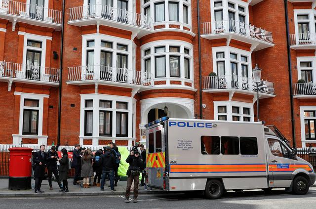 A police van is seen outside the Ecuadorian embassy after WikiLeaks founder Julian Assange was arrested by British police in London, Britain, April 11, 2019. REUTERS/Peter Nicholls