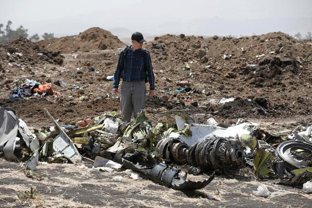 FILE PHOTO -American civil aviation and Boeing investigators search through the debris at the scene of the Ethiopian Airlines Flight ET 302 plane crash, near the town of Bishoftu, southeast of Addis Ababa, Ethiopia March 12, 2019. REUTERS/Baz Ratner/File Photo