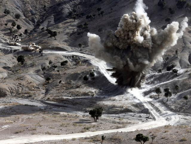 FILE PHOTO: U.S. soldiers blows up a roadside bomb set up by Taliban fighters near the town of Walli Was in Paktika province, near the border with Pakistan, November 4, 2012. Picture taken November 4, 2012. REUTERS/Goran Tomasevic/File Photo