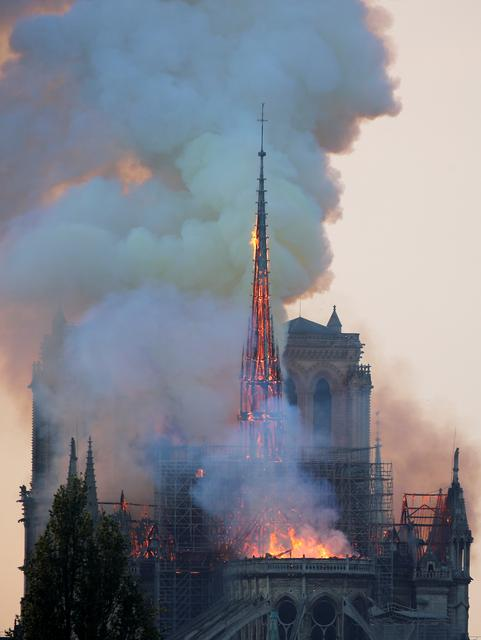 FILE PHOTO: Smoke billows from Notre Dame Cathedral after a fire broke out, in Paris, France April 15, 2019. REUTERS/Charles Platiau