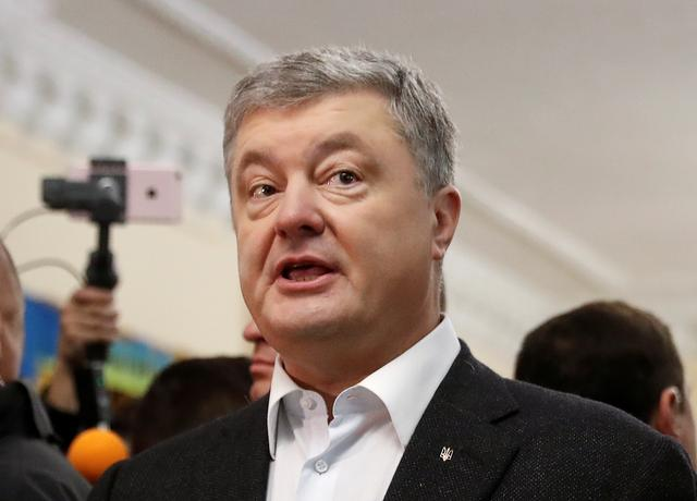 Ukraine's incumbent President and presidential candidate Petro Poroshenko addresses the media at a polling station during the second round of a presidential election in Kiev, Ukraine April 21, 2019. REUTERS/Vasily Fedosenko