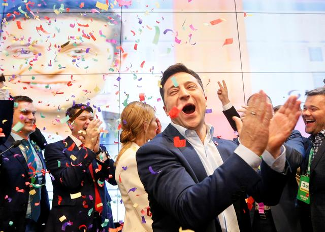 Ukrainian presidential candidate Volodymyr Zelenskiy reacts following the announcement of the first exit poll in a presidential election at his campaign headquarters in Kiev, Ukraine April 21, 2019. REUTERS/Valentyn Ogirenko