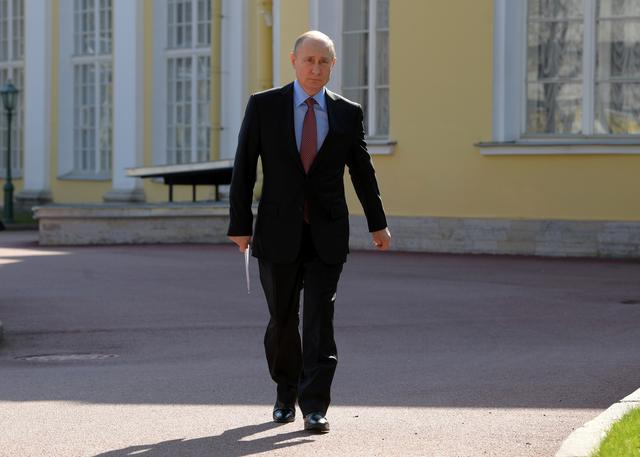 Russian President Vladimir Putin walks before a meeting with lawmakers in Saint Petersburg, Russia April 24, 2019. Sputnik/Alexei Druzhinin/Kremlin via REUTERS