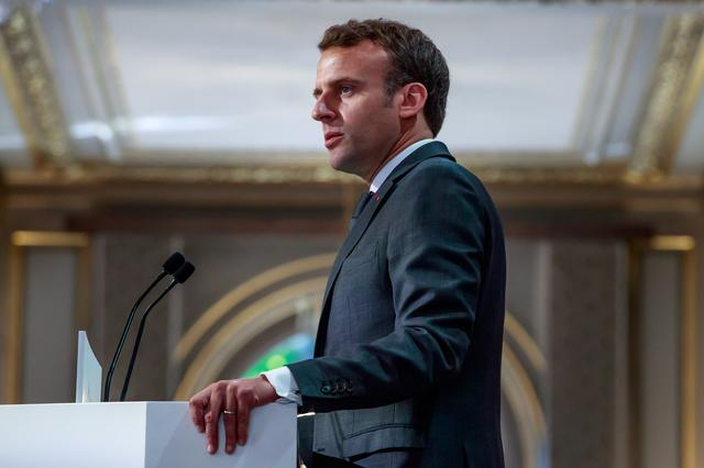 French President Emmanuel Macron delivers a speech for the Parisian Firefighters' brigade and security forces who took part at the fire extinguishing operations during the Notre Dame of Paris Cathedral fire, at Elysee Palace in Paris, France, April 18, 2019. Christophe Petit Tesson/Pool via REUTERS
