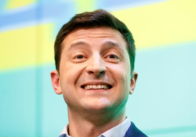 FILE PHOTO: Ukrainian presidential candidate Volodymyr Zelenskiy reacts during a news conference at his campaign headquarters following a presidential election in Kiev, Ukraine April 21, 2019. REUTERS/Valentyn Ogirenko/File Photo/File Photo
