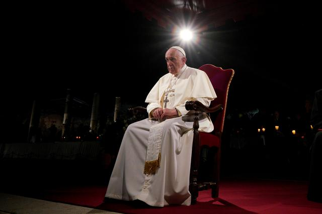 FILE PHOTO: Pope Francis presides over the Via Crucis (Way of the Cross) torchlight procession on Good Friday, in front of Rome's Colosseum, in Rome, Italy Friday, April 19, 2019. Andrew Medichini/Pool via REUTERS
