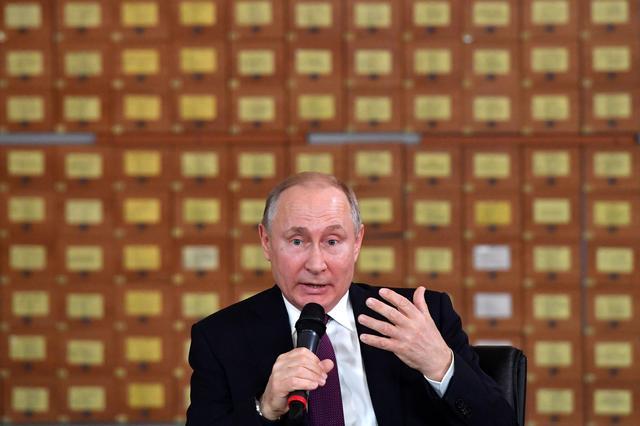 Russian President Vladimir Putin meets with members of the public in Simferopol, Crimea March 18, 2019. Yuri Kadobnov/Pool via REUTERS