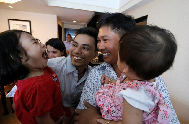 Reuters reporters Wa Lone and Kyaw Soe Oo celebrate with their children after being freed from prison, after receiving a presidential pardon in Yangon, Myanmar, May 7, 2019. REUTERS/Ann Wang/Pool