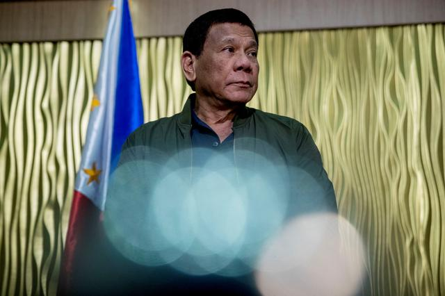 FILE PHOTO:  Philippines President Rodrigo Duterte arrives to greet the U.S. Secretary of State Mike Pompeo at Colonel Jesus Villamor Air Base in Manila, Philippines, Thursday, February 28, 2019. Andrew Harnik/Pool via REUTERS
