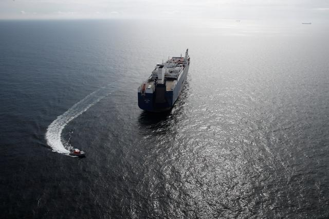 A French patrol boat sails next to the Bahri-Yanbu, a Saudi Arabian cargo ship, that waits to enter in the port of Le Havre, as human rights groups try to block the loading of weapons onto the vessel, France, May 10, 2019. REUTERS/Benoit Tessier