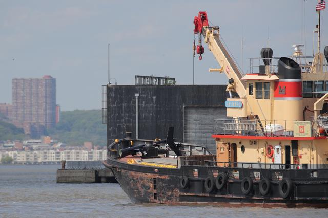 64f0d35af05b01 A section of a Helicopter that crashed into the Hudson River is seen on the  deck