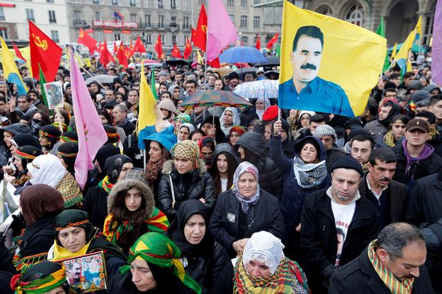 FILE PHOTO: Members of the Kurdish community in France rally in protest at the murder of three female Kurdish activists found shot to death in the Kurdish Information Centre in Paris, January 12, 2013. REUTERS/Christian Hartmann/File Photo