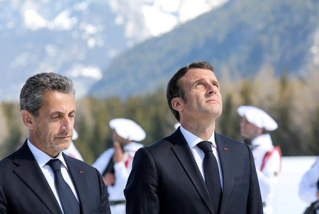 FILE PHOTO: French President Emmanuel Macron and his predecessor Nicolas Sarkozy attend a ceremony in tribute to World War II resistance fighters killed at the plateau des Glieres, near Thorens-Glieres, France March 31, 2019. Ludovic Marin/Pool via REUTERS/File Photo
