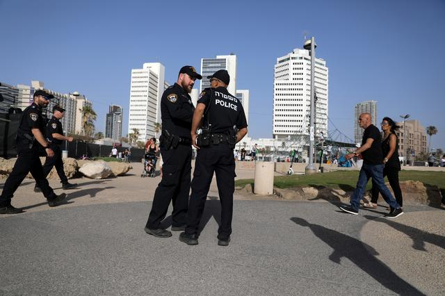 Israeli policemen patrol the area near the beach on the eve of the 2019 Eurovision song contest final in Tel Aviv, Israel May 18, 2019 REUTERS/ Ammar Awad