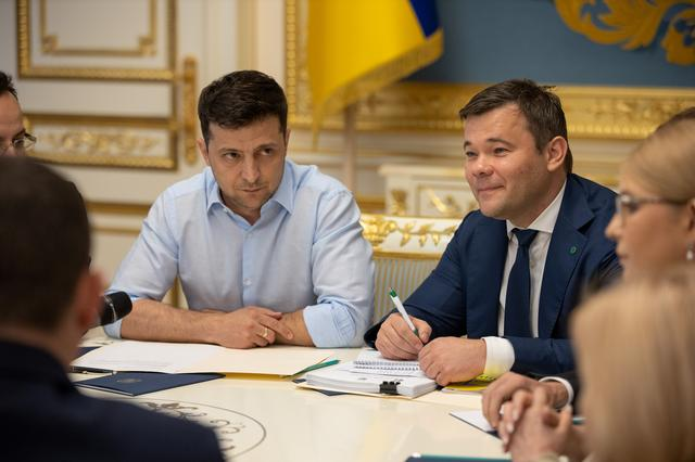 President of Ukraine Volodymyr Zelenskiy (L) and his lawyer and adviser Andriy Bogdan (R) attend a meeting with lawmakers in Kiev, Ukraine May 21, 2019. Ukrainian Presidential Press Service/Handout via REUTERS