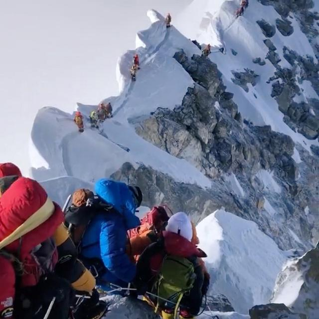 Climbers descend from the summit of Everest down the Hillary Step and across the cornice traverse to the South Summit, Nepal May 23, 2019 in this picture obtained from social media on May 27, 2019. CLIMBING THE SEVEN SUMMITS/@TENDIGUIDE/via REUTERS