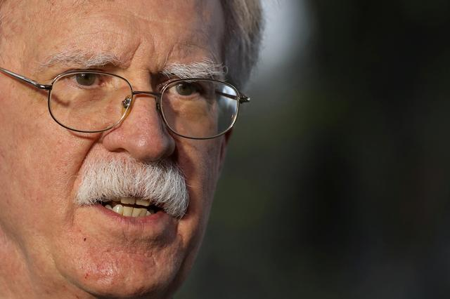 FILE PHOTO: U.S. National Security Advisor John Bolton speaks during an interview at the White House in Washington, U.S., March 29, 2019. REUTERS/Brendan McDermid/File Photo