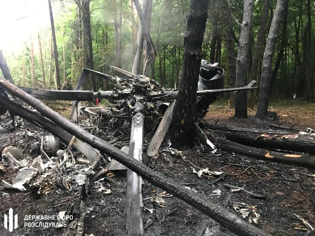 A view shows the crash site of a military helicopter Mi-8 in Rivne Region, Ukraine in this handout photo released by State Bureau of Investigation May 30, 2019. Ukraine's State Bureau of Investigation/Handout via REUTERS