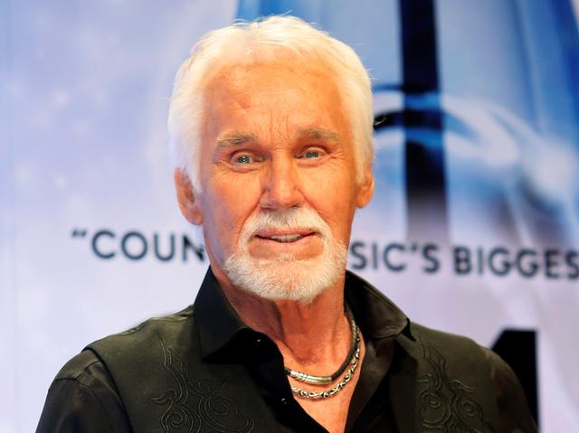 FILE PHOTO: Kenny Rogers poses backstage after accepting the Willie Nelson Lifetime Achievement award at the 47th Country Music Association Awards in Nashville, Tennessee Nov . 6, 2013. REUTERS/Eric Henderson/File Photo