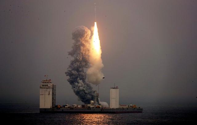 A Long March 11 carrier rocket takes off from a mobile launch platform in the Yellow Sea off Shandong province, China June 5, 2019. China Daily via REUTERS
