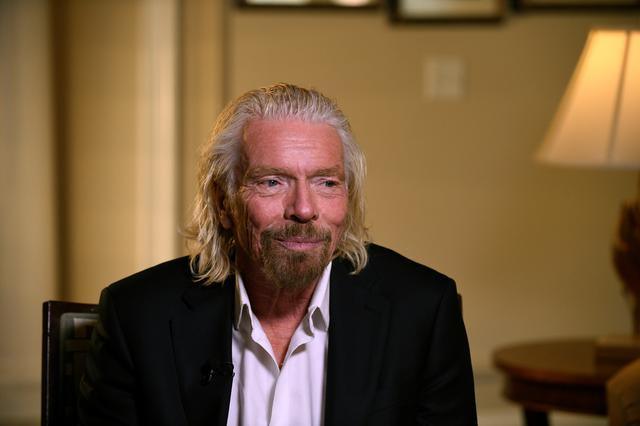 Virgin Galactic founder Richard Branson speaks during an interview while attending the Space Symposium in Colorado Springs, Colorado, U.S., April 11, 2019. REUTERS/Kelsey Brunner