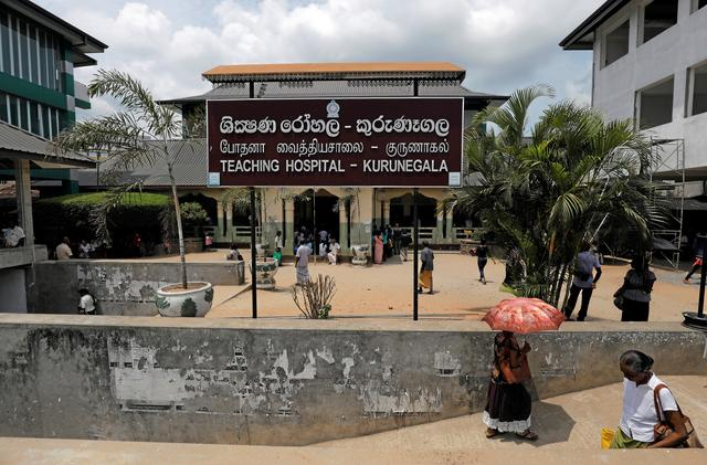 A general view of a hospital where women wait to make statements and complains against Muslim doctor Segu Shihabdeen Mohamed Shafi, who was arrested after accusations of secretly sterilising Buddhist women during their caesarean deliveries inside a hospital in Kurunegala, Sri Lanka May 31, 2019. Picture taken May 31, 2019. REUTERS/Dinuka Liyanawatte