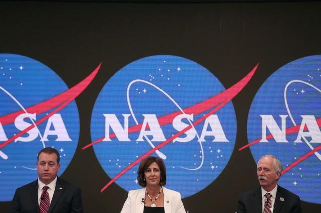 CFO NASA Headquarters' Jeff DeWit, Robyn Gatens, Deputy Director, International Space Station at NASA Headquarters, and Bill Gerstenmaier, Associate Administrator, NASA's Human Exploration and Operations Mission Directorate, NASA  Headquarters, sit during a news conference announcing that NASA is opening the International Space Station for commercial business, so U.S. industry innovation and ingenuity can accelerate a commercial economy in low-Earth orbit, at the NASDAQ Market site at Times Square in New York City, U.S., June 7, 2019.  REUTERS/Shannon Stapleton
