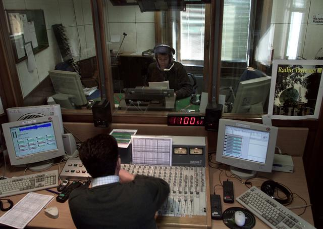 FILE PHOTO: A Vatican Radio reporter speaks during a live programme on April 10, 2001./File Photo