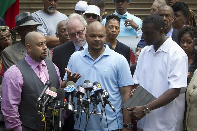 "FILE PHOTO - Wrongly convicted ""Central Park Five"" members Raymond Santana, Kevin Richardson and Yusef Salaam (front L-R) attend a news conference announcing the payout for the case at City Hall in New York June 27, 2014.  REUTERS/Carlo Allegri"