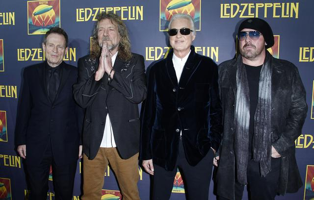 "FILE PHOTO - Members of British rock band Led Zeppelin (L-R) bass player John Paul Jones, lead singer Robert Plant, guitarist Jimmy Page and drummer Jason Bonham, who replaces the band's original drummer his father John Bonham, arrive for the premiere of their film ""Celebration Day"", in New York October 9, 2012. REUTERS/Carlo Allegri"
