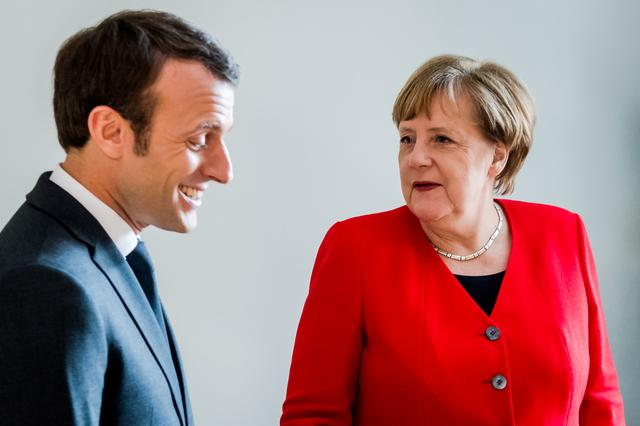 FILE PHOTO: French President Emmanuel Macron and German Chancellor Angela Merkel meet on the sidelines of an EU summit in Brussels, Belgium March 21, 2019. Geert Vanden Wijngaert/Pool via Reuters/File Photo