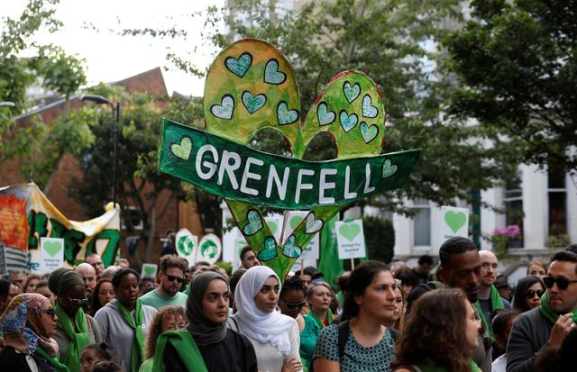 FILE PHOTO - Participants in a Silent March mark the first anniversary of the Grenfell Tower fire in London, Britain June 14, 2018. REUTERS/Peter Nicholls